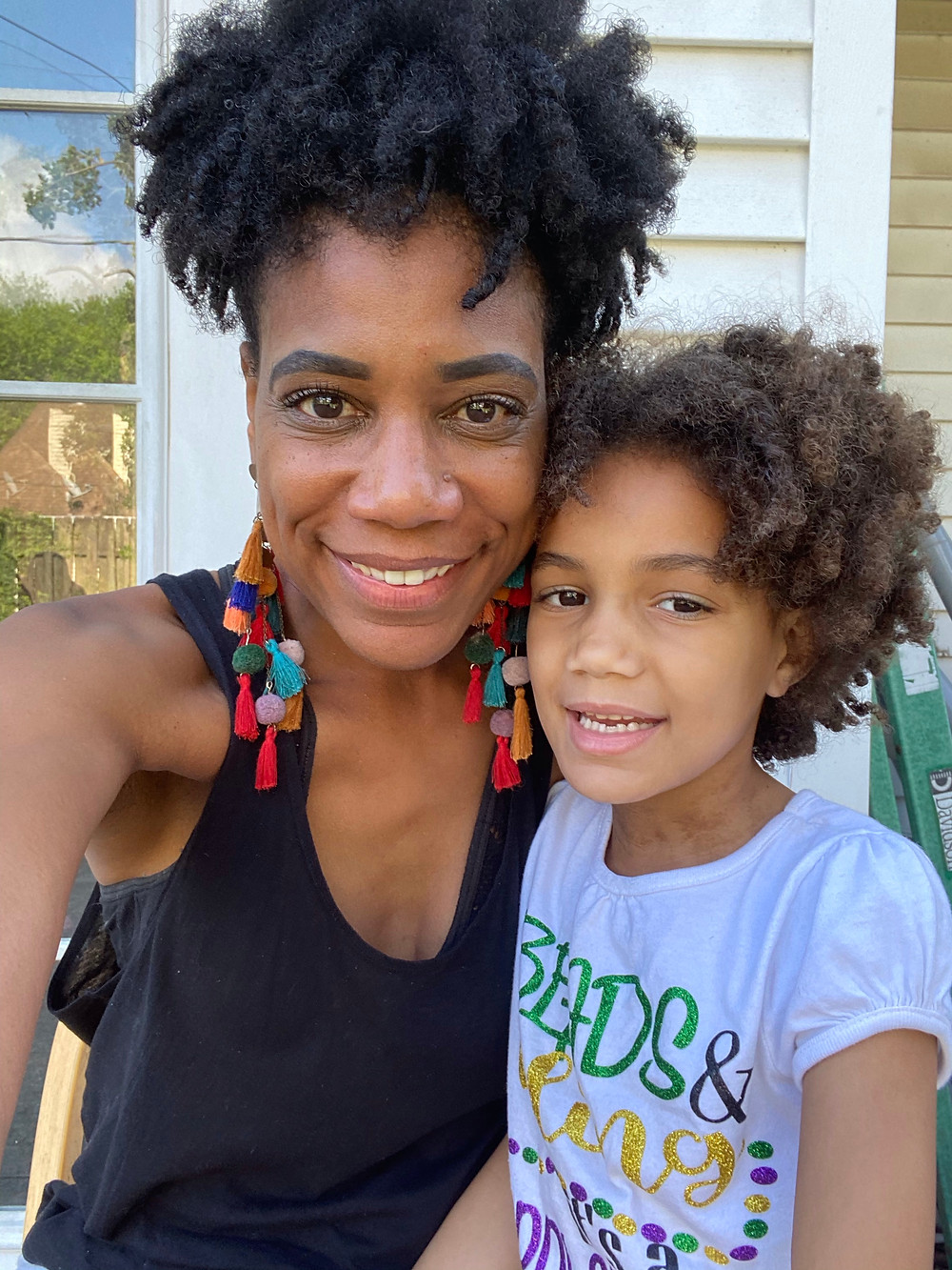 Mother And Daughter With Curly Hair