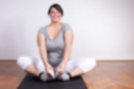 Woman who is smiling and stretching