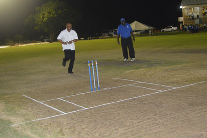 Director Kenneth Jones delivering the first ball at a sponsored Cricket Tournament.