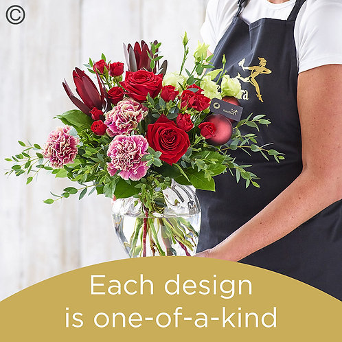 Christmas hand-tied bouquet and vase made with the finest flowers