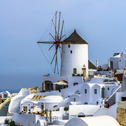 Old windmill in the city center of Oia