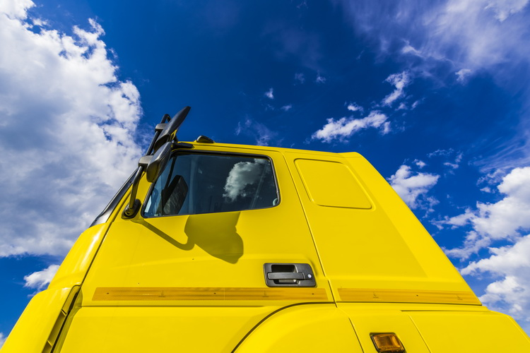 The sky above the yellow truck cab