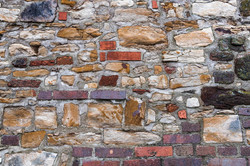 On the background of old stone walls