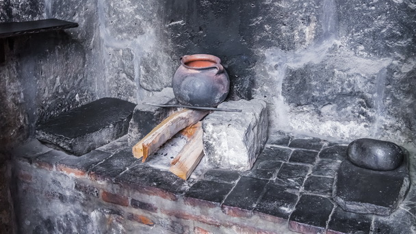 The old hearth with a cast iron boiler
