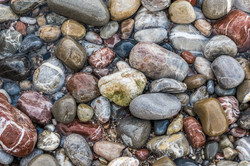 Colorful stones in the surf