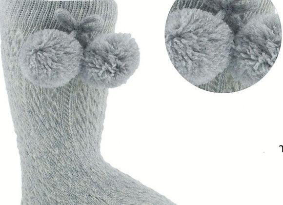 Grey pom pom knee