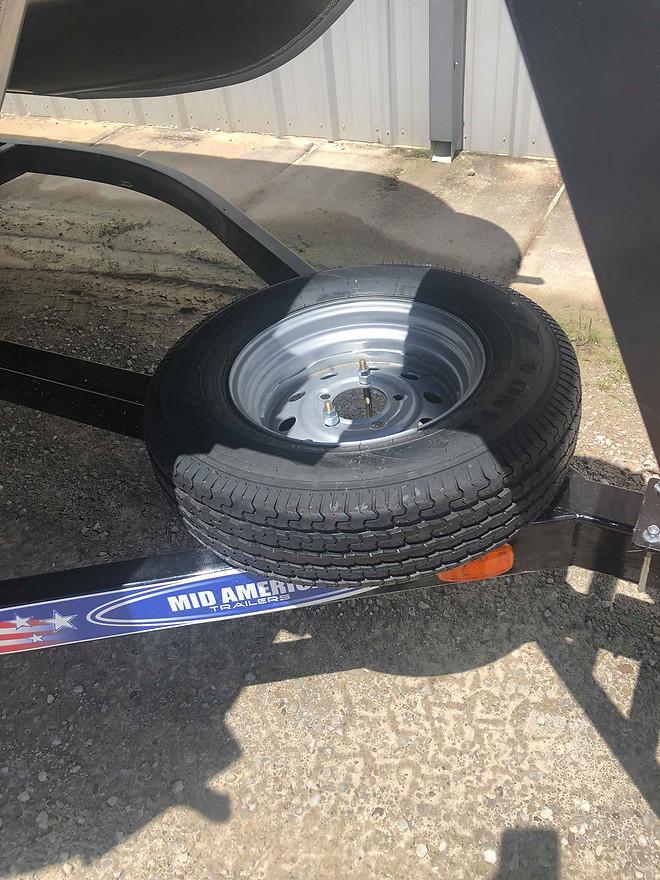 Spare Tire on Tandem Axle Trailer.jpg