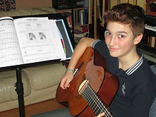 young male guitar student