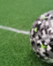 Futsal ball on soccer pitch.jpg