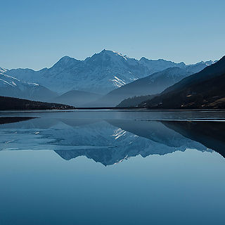 Mountains and lake image that links to Transcranial Magnetic Stimulation information page.