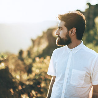 Image of gentleman with beard looking into the distance which links to ADD/ADHD information page.