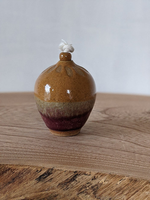 Small glazed stoneware oil lamp