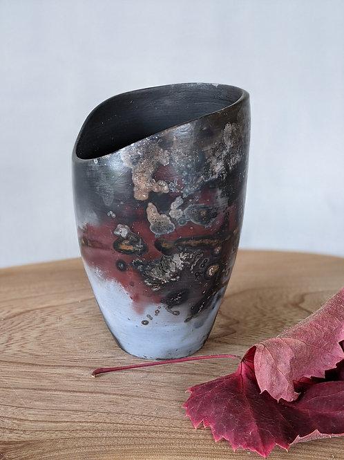 Wheel thrown irregular top barrel fired pot