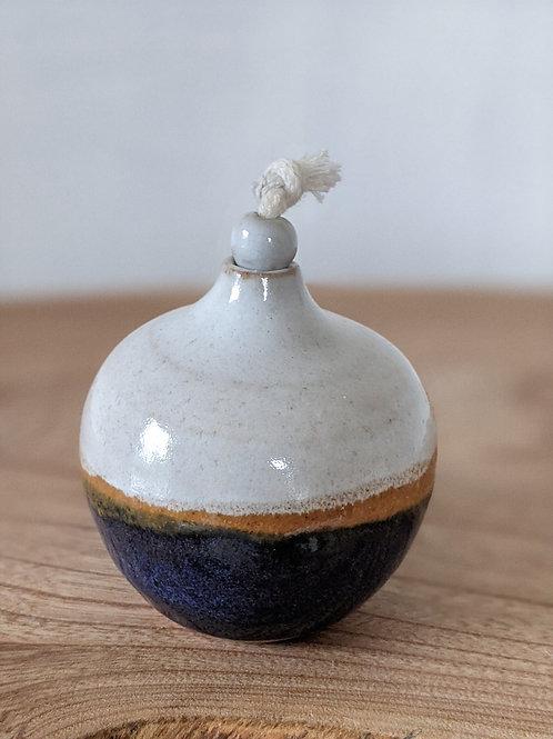 Small glazed stoneware oil lamp