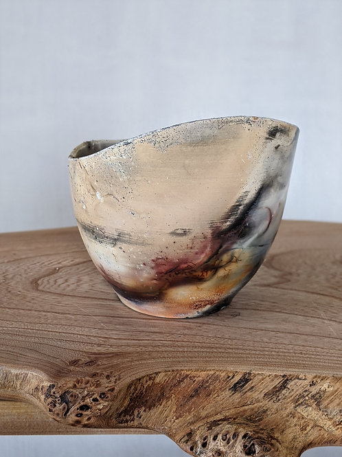 Wheel thrown modified pit fired vessel