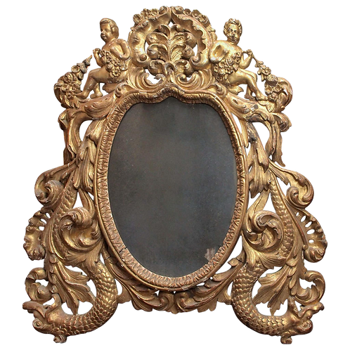 PIERCED GILTWOOD MIRROR WITH PUTTI AND SEA CREATURES