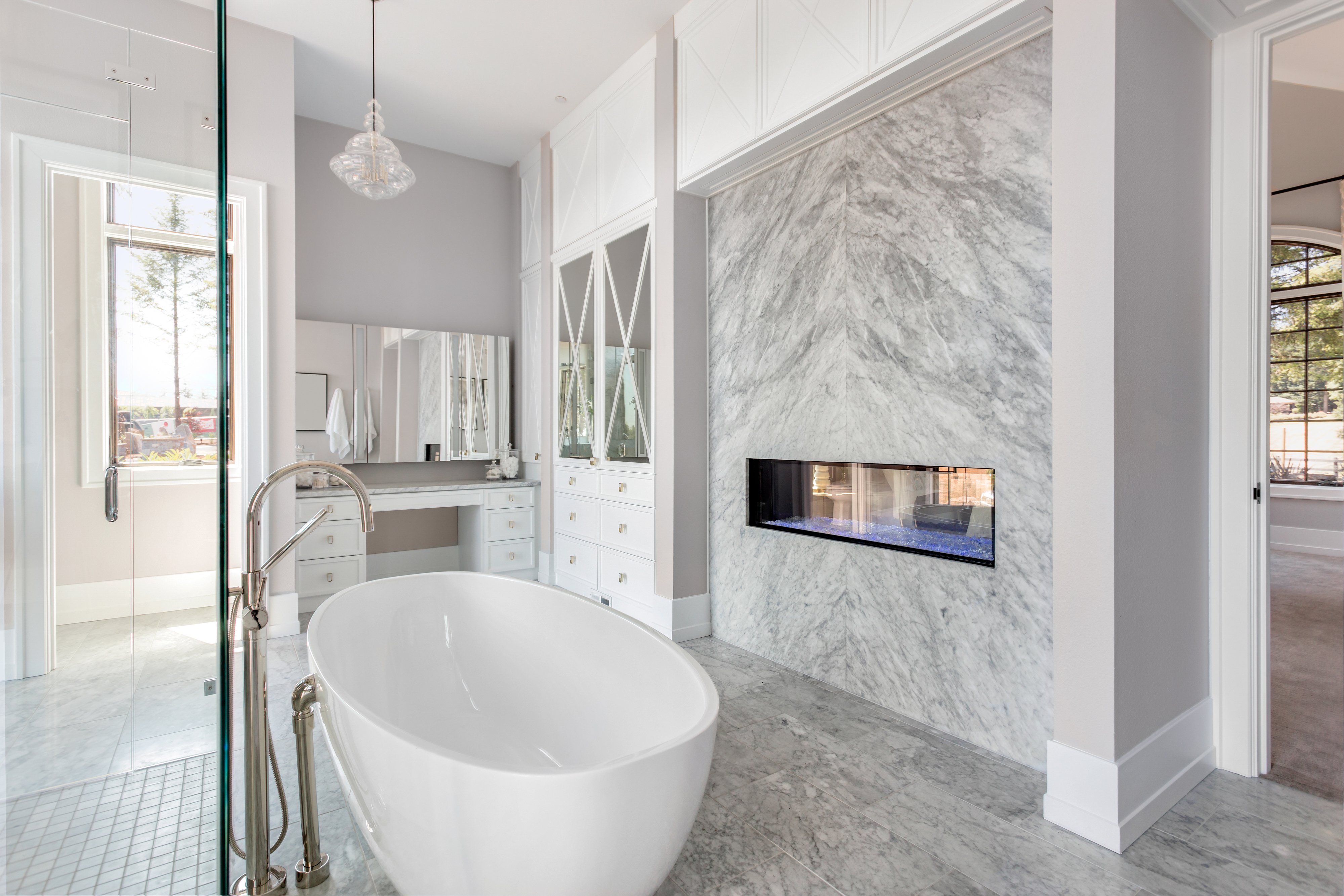 Elegant bathroom with fireplace and bath