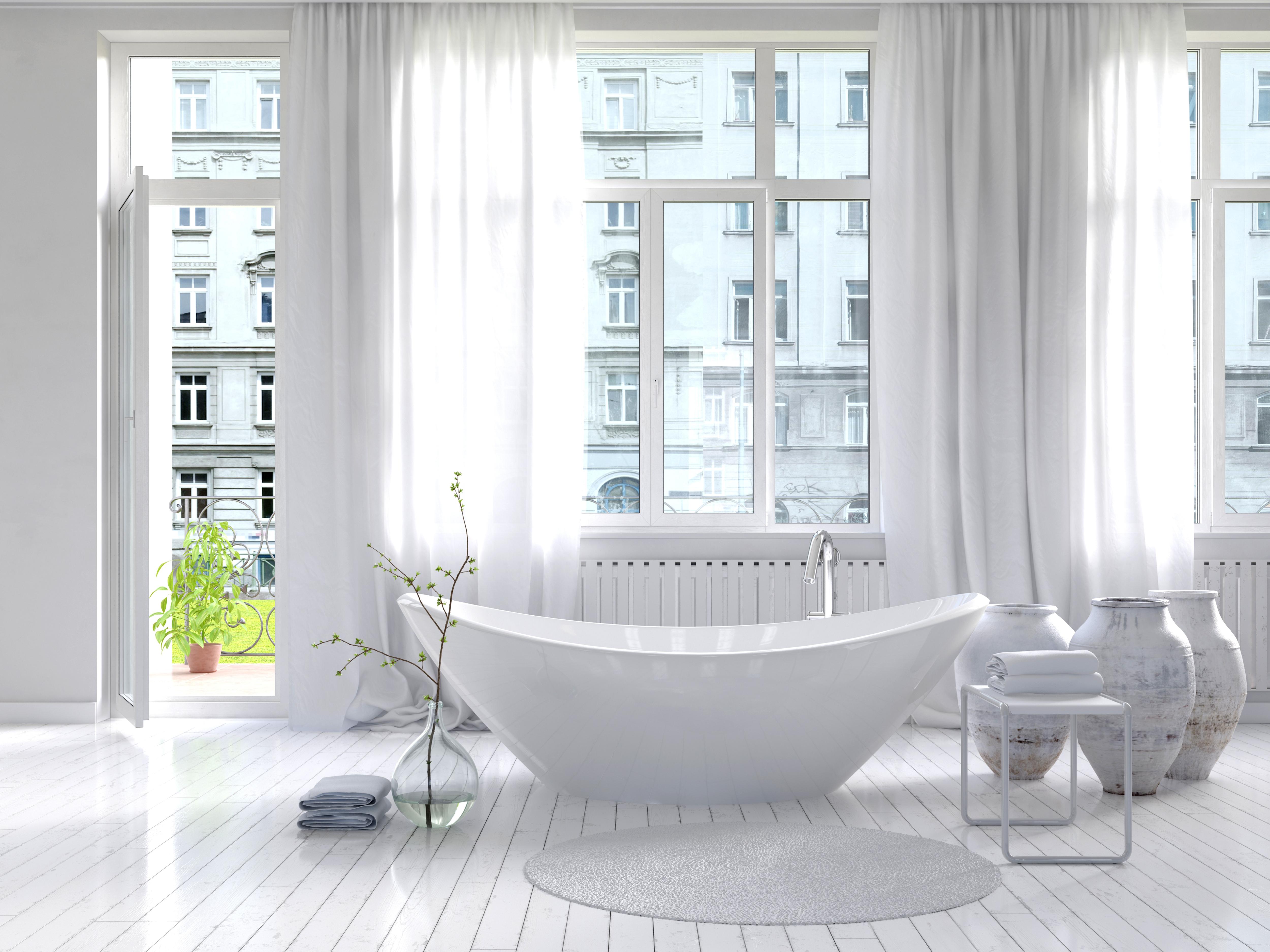 Pure white bathroom interior with separa