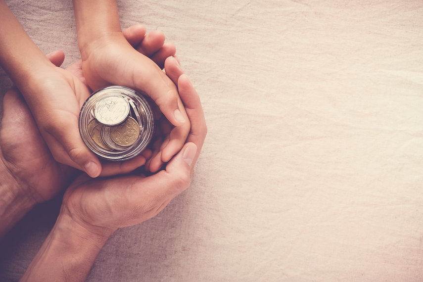 child-adult-holding-money-jar-donation-s