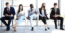 stressful-business-people-waiting-job-interview-with-face-mask-social-distancing-quarantin