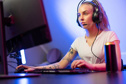 professional-gamer-girl-with-headset-pla