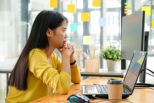 asian-female-programmer-sitting-with-han