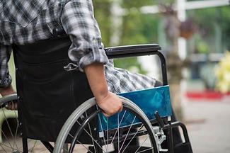 close-up-senior-woman-hand-wheel-wheelch
