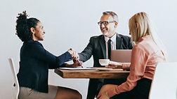 businesswoman-handshake-with-businessman.jpg