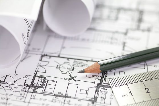 Architect-rolls-and-plans-construction-p