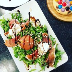 Red wine poached pear & prosciutto salad