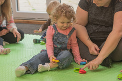 Mum and child exploring our castanets
