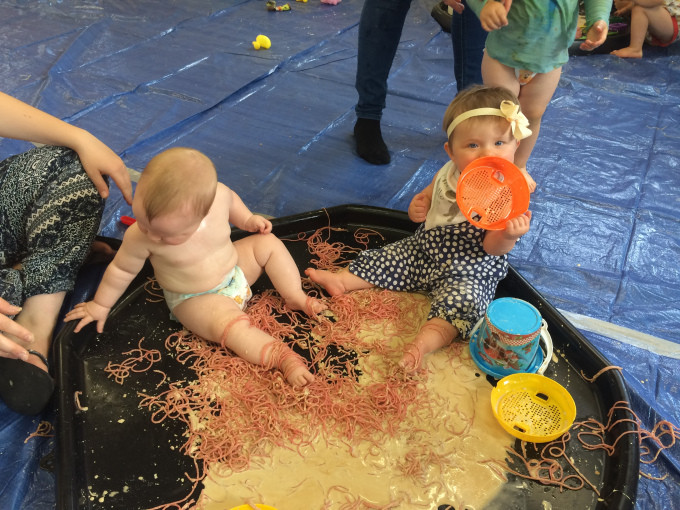 Children sitting in Spaghetti and Coffee Gloop