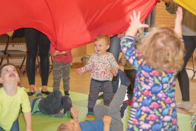 Children enjoying a parachute game