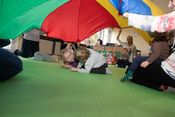 Two girls enjoying the parachute