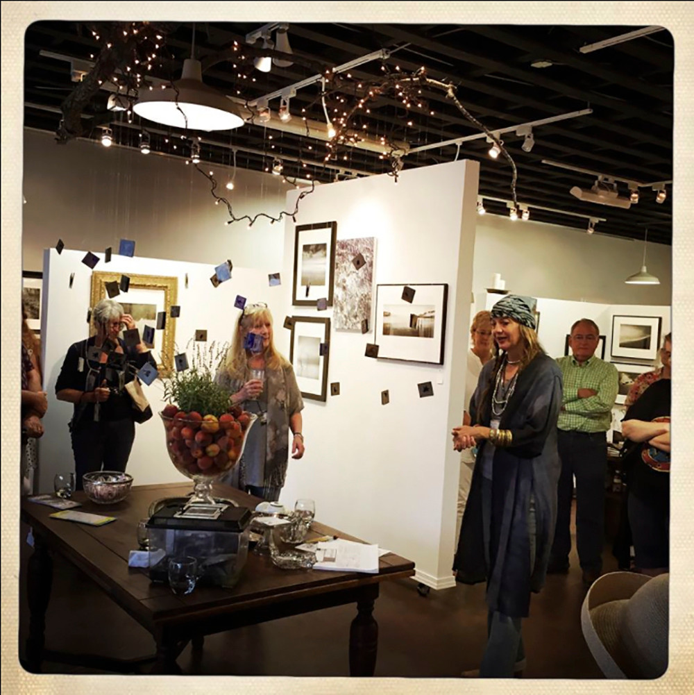 """S.Gayle Stevens discusses the work selected for """"Water."""" Photo by Aubrey Guthrie II"""