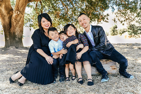 Michelle, owner with Chef Go and their 3 children.