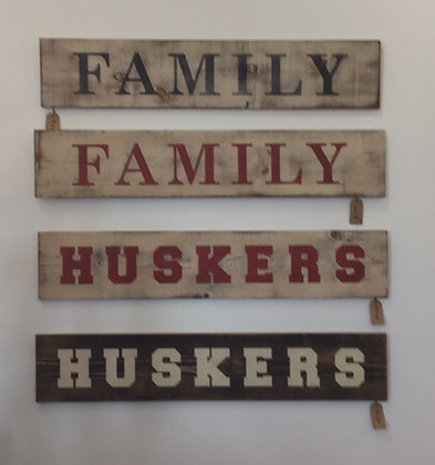 Family and Husker signs