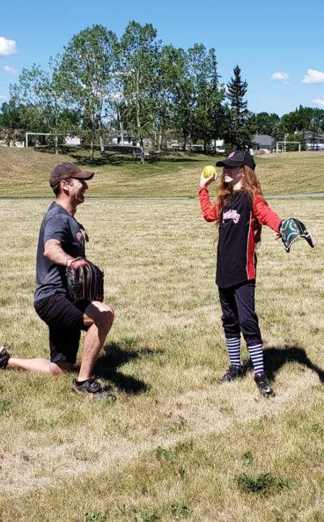coach-player-kneeling-throw.jpg