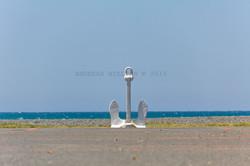 Ankerskulptur ved havet i Napier.