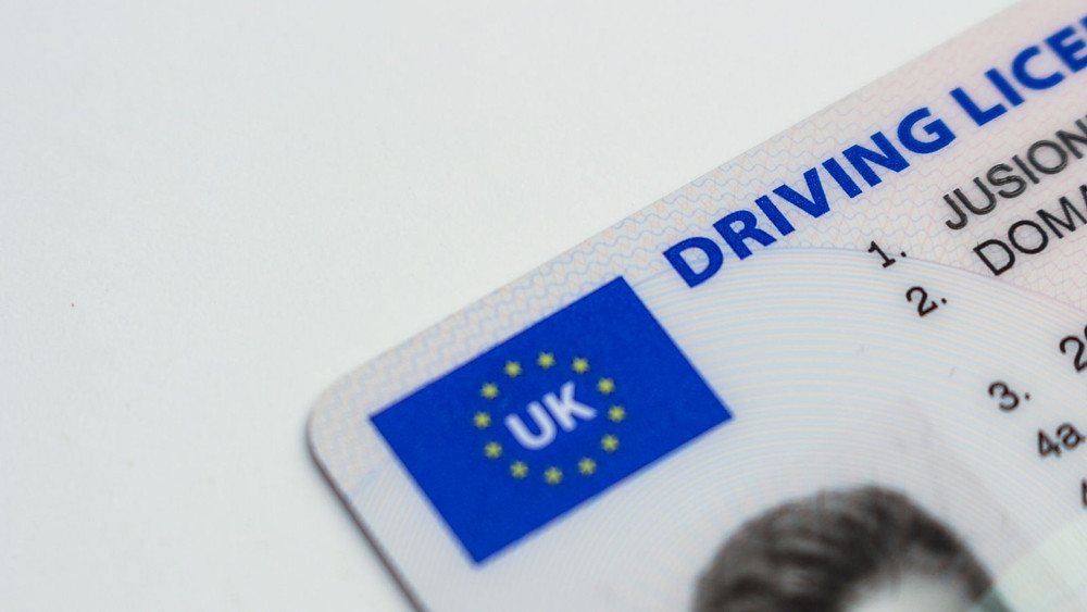 Picture of the corner of a UK driving licence