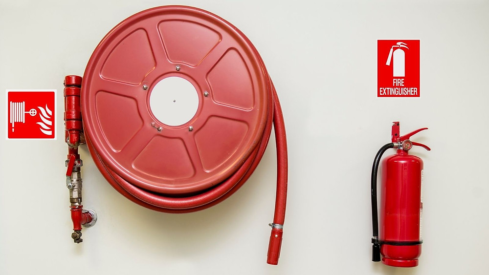 Picture of a fire hose and fire extinguisher