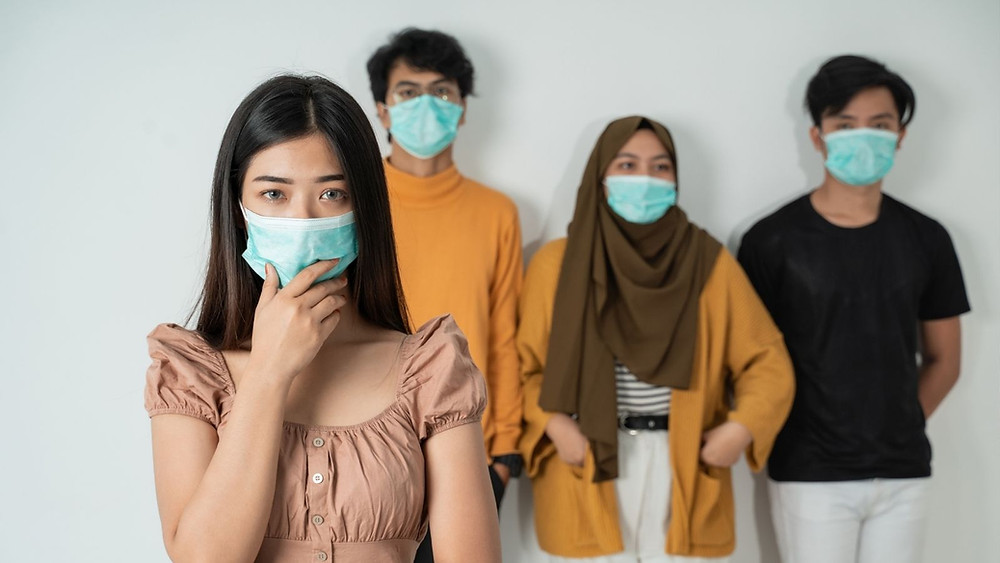 Pictures of 4 different people wearing face masks