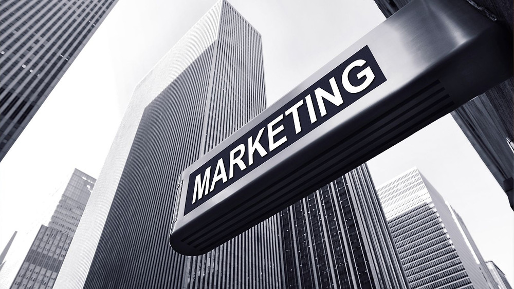 Picture of some skyscrapers and the word marketing attached to a building