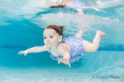 Underwater photo of baby girl