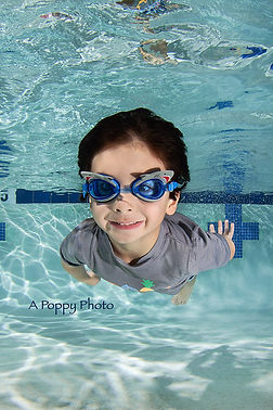 Boy with shark goggles swimming