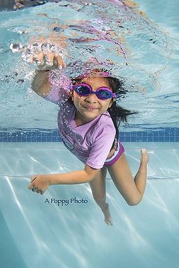 girl in purple swimsuit