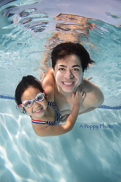 underwater image of dad and daughter
