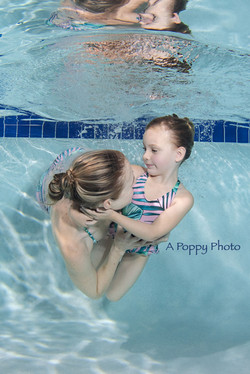 underwater image of mom and daughter