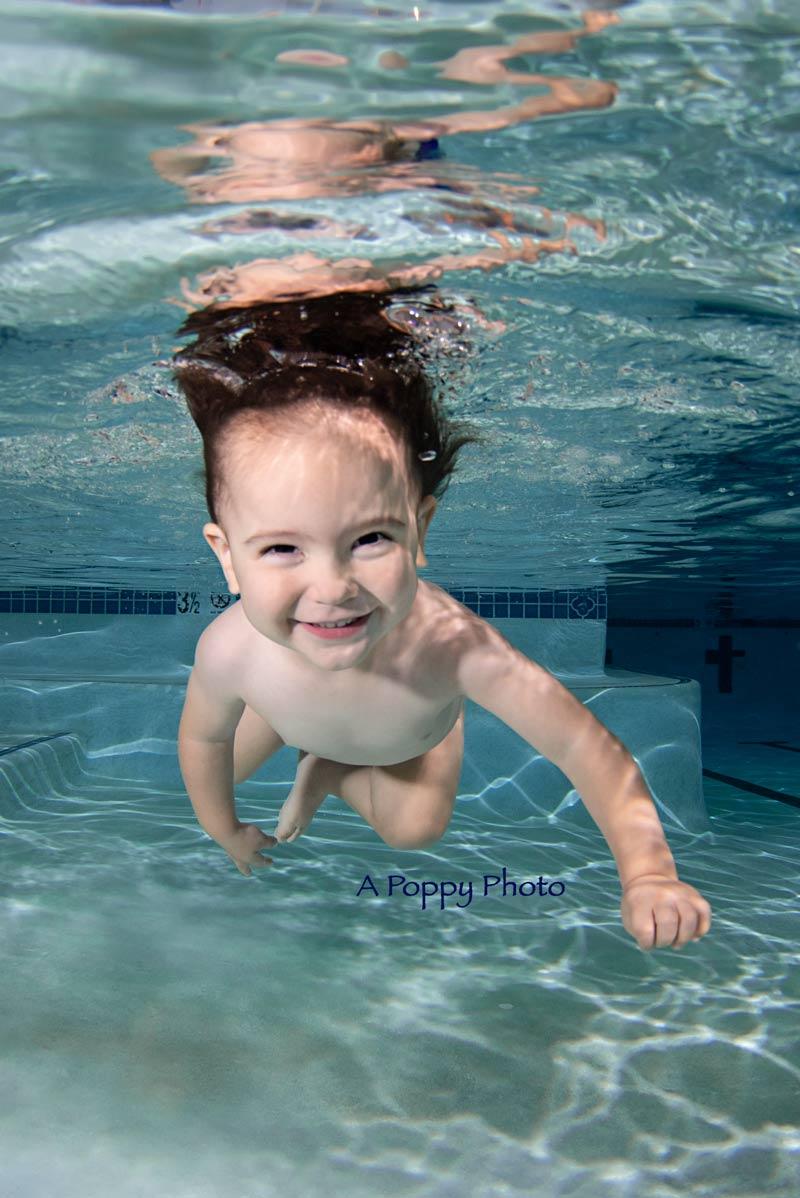 underwater image of toddler swimming