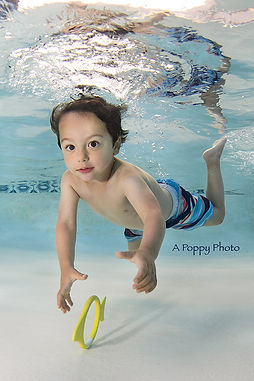 boy swimming for rings